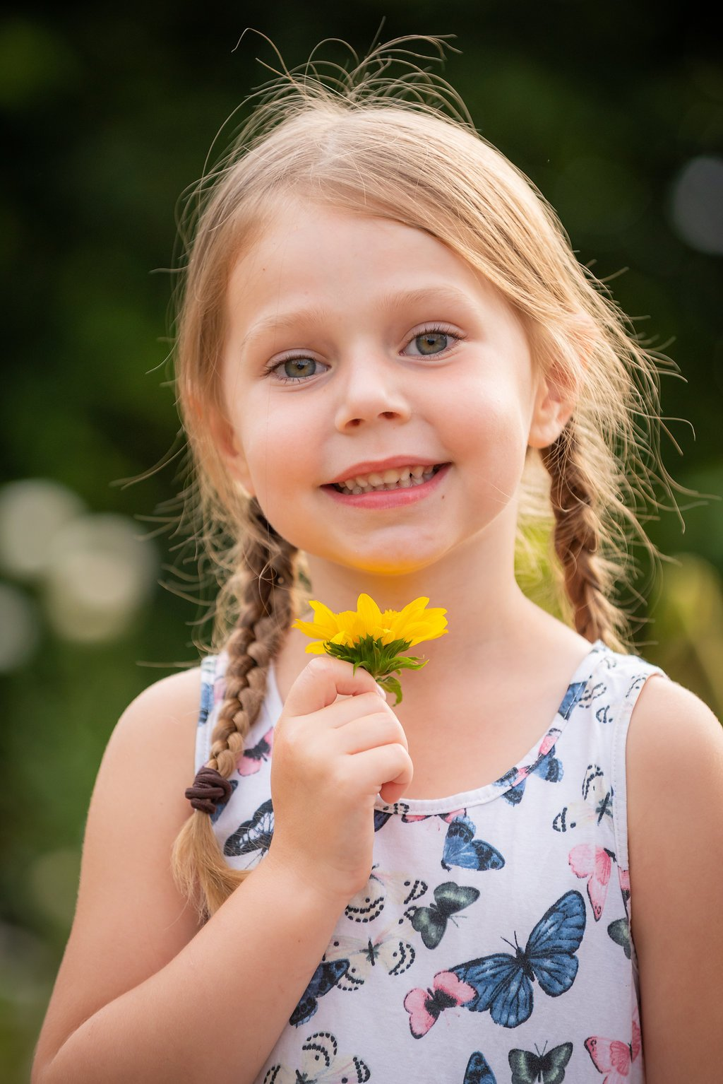 Girl with flower by Robert Nelson Family Photography